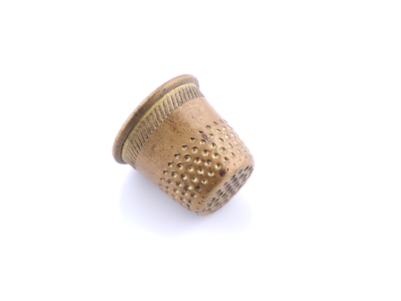 metal thimble for sewing on white background