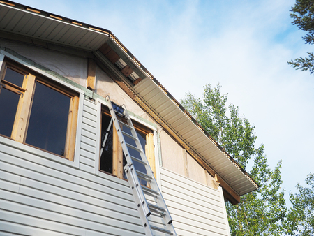Construction of the frame house. Siding installation