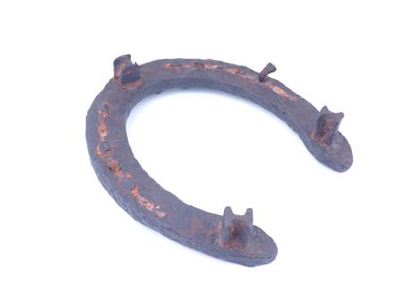 old rusty horseshoe on a white background