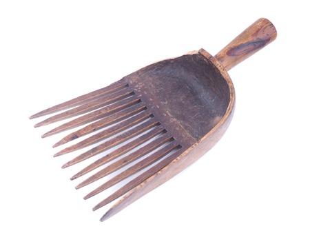 wooden rake on white background