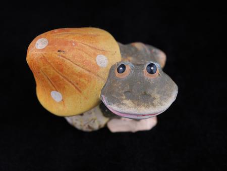 frog with mushroom. children's toy Standard-Bild - 117091285