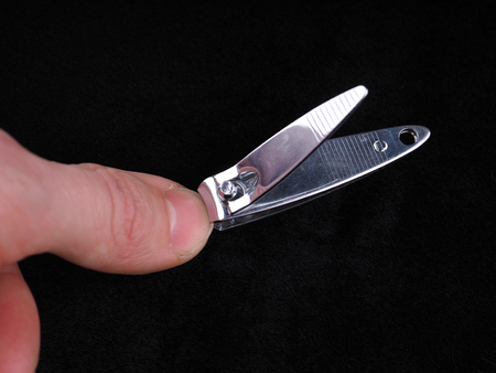 nail clippers on black background Standard-Bild