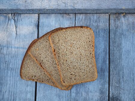 sliced bread on a wooden background