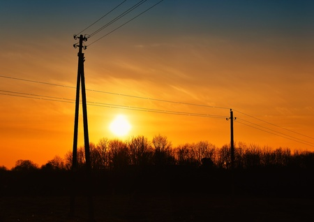 Sunset with high voltage power lines, panorama Stock Photo - 9997339