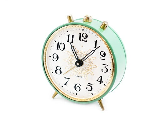 close p: Vintage alarm clock isolated on white background
