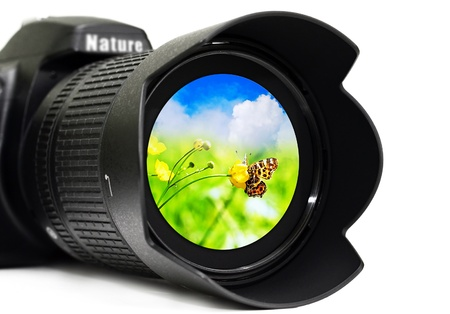 Camera lens with butterfly inside, isolated on white background