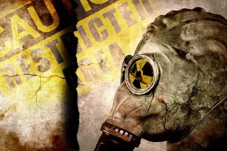 Man in gasmask on cracked wall, industrial grunge background