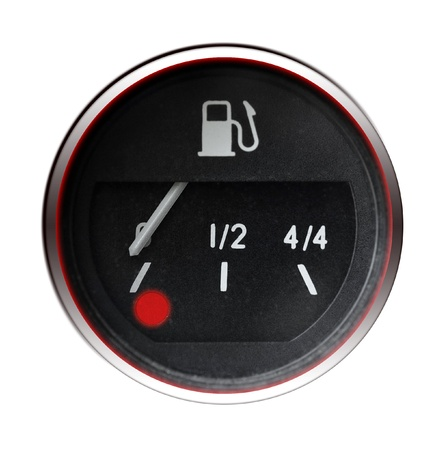 Old car fuel indicator isolated on white photo