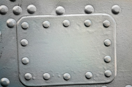 Metal plate with rivets, grunge riveted metal texture Stock Photo - 10568421