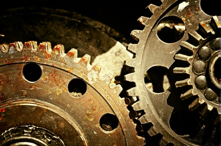 Mechanical gears close up, industrial grunge background Stock Photo