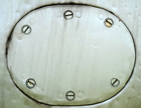 Metal plate with rivets, grunge riveted metal texture photo