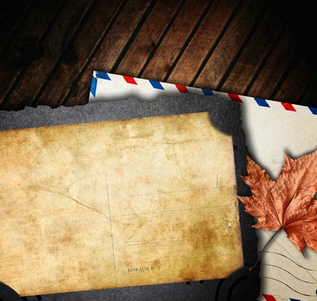Vintage composition, old paper and envelope with maple leaf, retro background photo
