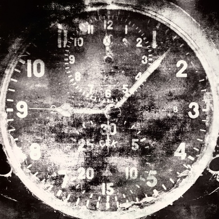 Vintage military airplane clock, industrial grunge background