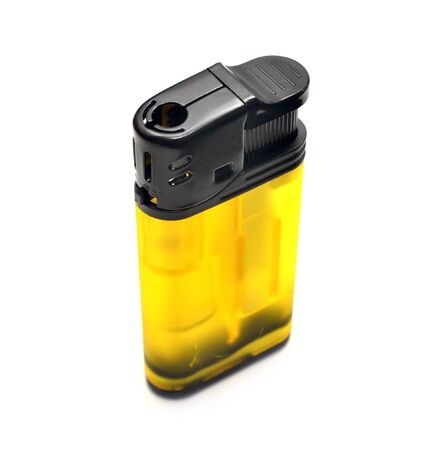 Yellow lighter isolated on white background close up photo