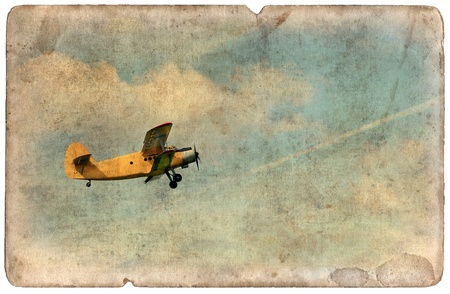 Vintage military postcard isolated on white background, flying old biplane photo