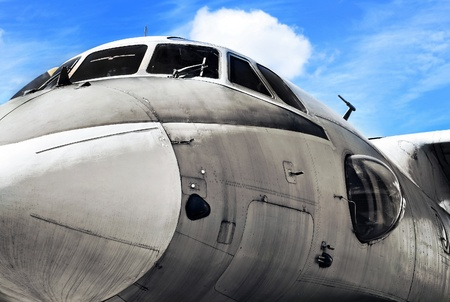 Military aircraft against blue sky, close up, grunge background photo