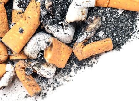 Cigarette stubs on white background photo