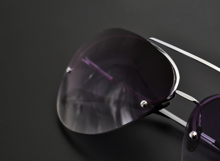 Sunglasses on black background photo