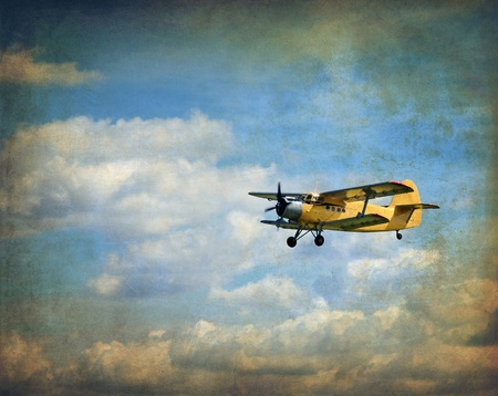 Flying biplane, vintage background photo
