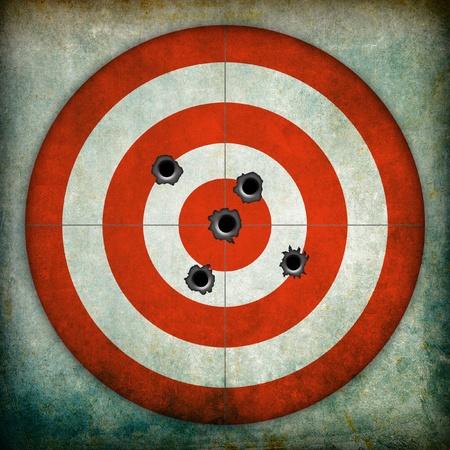 shooting target: Doel met kogelgaten, grunge achtergrond