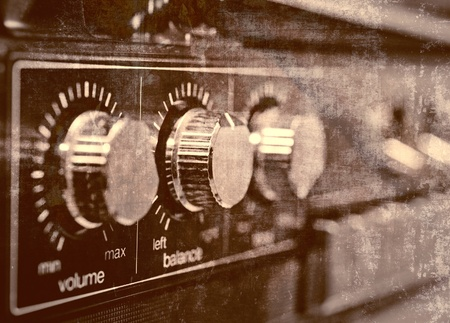 Old amplifier, grunge background photo