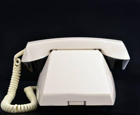 retro phone: Old Phone on black background