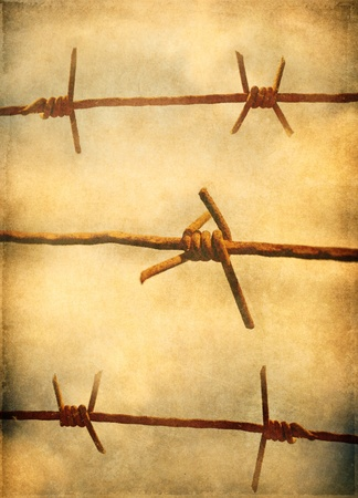 Barbed wire, grunge background photo