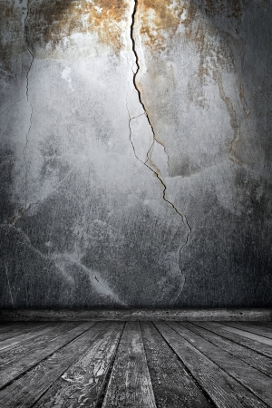 Room interior with cracks Stock Photo