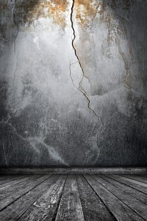 Room interior with cracks Stock Photo