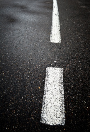 Wet asphalt road close up photo