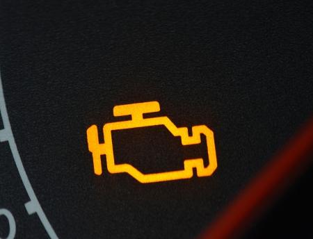 failure sign: Malfunction or check engine car symbol, dash board close up