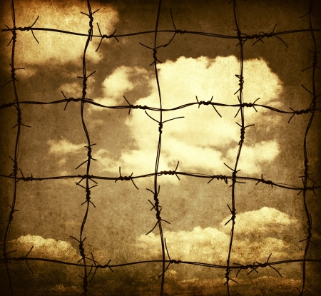 barbed wire fence: Barbed wire against sky, grunge illustration