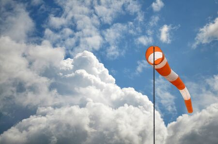 Windsock against blue sky and clouds Stock Photo