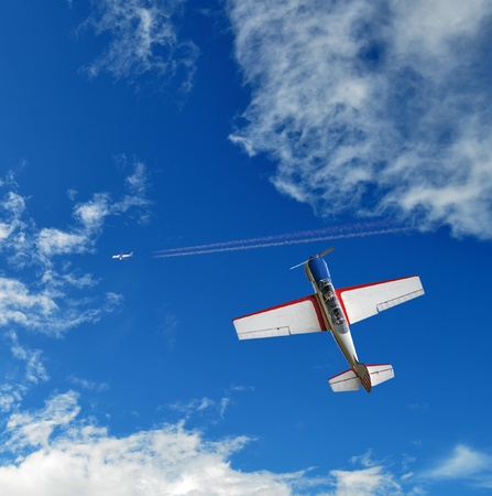 Aerobatic airplane in the blue sky photo