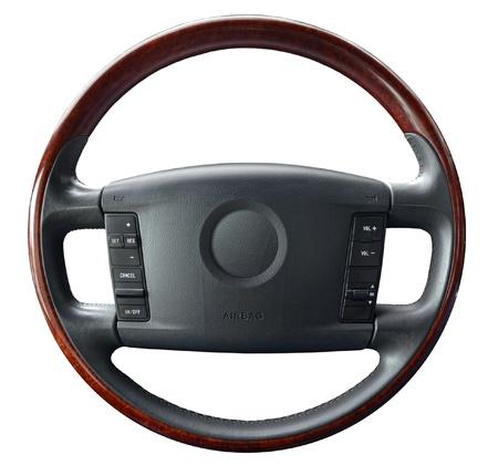 Steering wheel on white Imagens