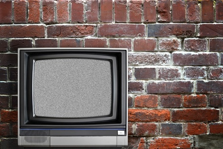 Vintage TV and brick wall photo