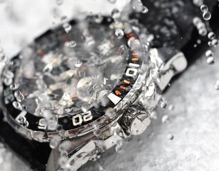 luxury watch, chronograph in water splash photo