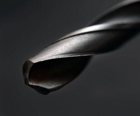 bit background: Drill bit on black background