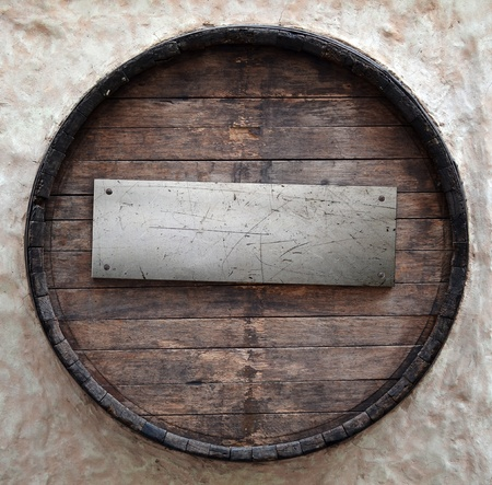 Old beer barrel with metal plate photo