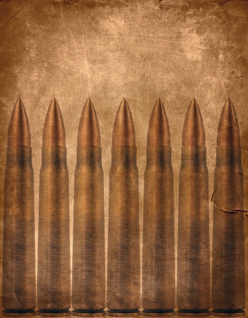 war crimes: Military background, bullets on scratched brown texture Stock Photo