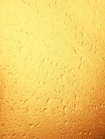 Water drops golden background Stock Photo - 20959868