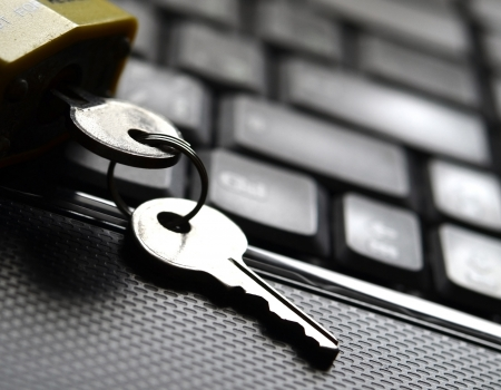 information security: Key on computer keyboard, Information security concept Stock Photo
