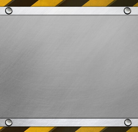 Metal plate with caution stripes photo