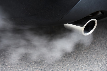 dirty car: Combustion fumes coming out of car exhaust pipe
