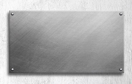 aluminium: Metal plate on concrete wall