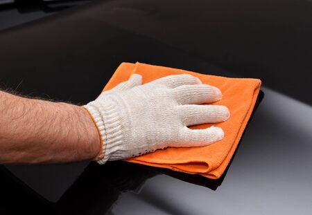 microfiber cloth: Cleaning car with microfiber cloth