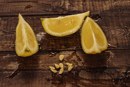 yellow, fresh lemon. lemon slices on wooden background.