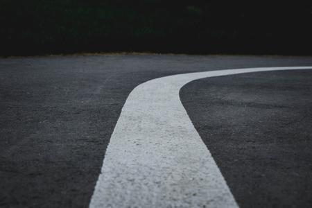 asphalt road with a white stripe in the center. white stripe indicates markup Banco de Imagens