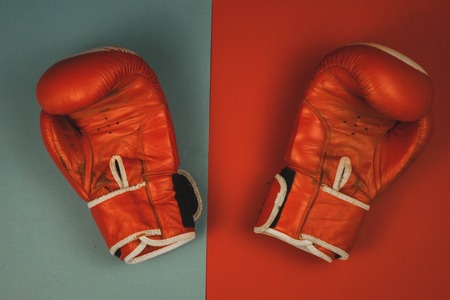 red boxing gloves on a red and blue background