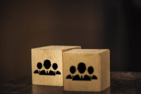 wooden cubes image of staff on a black background.